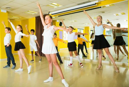 Children are dancing twist in class.