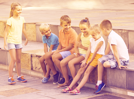 portrait of happy european children spending time outside and playing charades Imagens