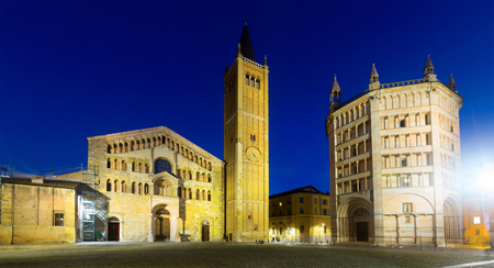 Parma cathedral and baptistery illuminated at dusk and Piazza Duomo in Italy Stock Photo