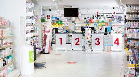 BADALONA, SPAIN  - FEBRUARY 20, 2018: Image of medicines arranged in shelves at modern pharmacy