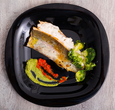 Delicious fried brook trout fillets with broccoli and tartare saucee