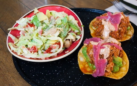 Mexican food of Tasty chicken salad with avocado and tuna tostada