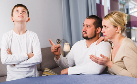Upset parents berating their son at home