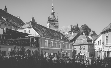 Image of view on Clock tower from streets in Sighisoara in Romania. Stock Photo