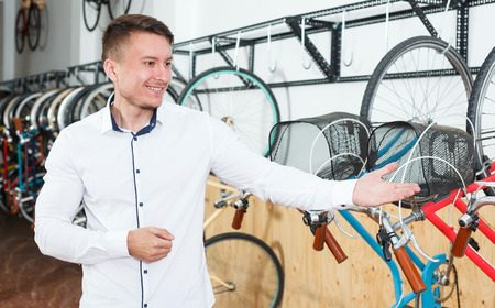 Portrait of male who is standing smile in the bike store. Stock fotó