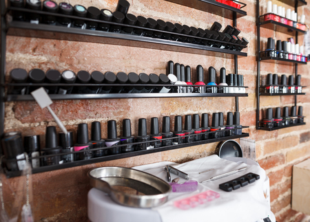 Image of work place with modern nail varnishes and equipment in nail studio Stock Photo