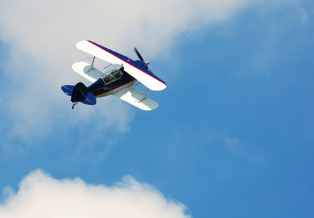 Image of sports plane flying rapidly  in the sky, outdoor photo