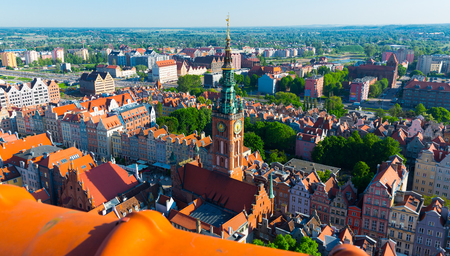 Aerial view of spire of Gdansk Main Town Hall on background of summer cityscape, Poland 写真素材