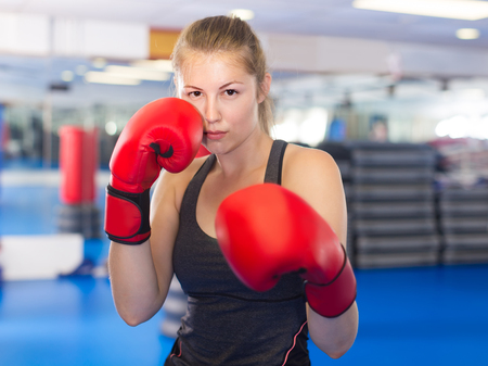 Portrait of young swiss  woman who is training in box gym.