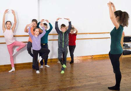 Diligent friendly  ballet dancers exercising in ballroom Standard-Bild
