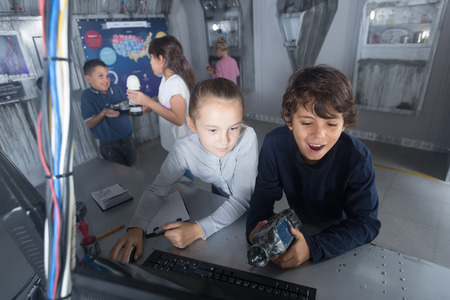 Focused kids look for a way out in quest room bunker