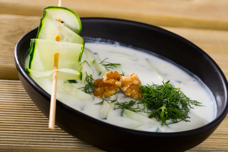 Traditional Bulgarian dish Tarator - cold soup from sour milk and cucumbers