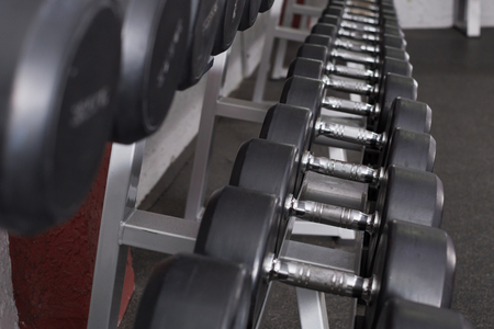 Dumbbell weights on rack for training equipment in gym Stock Photo