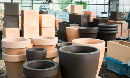 Photo of rows with clay pots for plants in orangery. Stockfoto