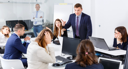 Businessman feeling  unhappy   to coworkers in office, pointing out mistakes in work Stock Photo