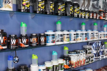 BARCELONA, SPAIN - APRIL 12, 2018: Shelves with sport  supplements in a sport food shop indoor