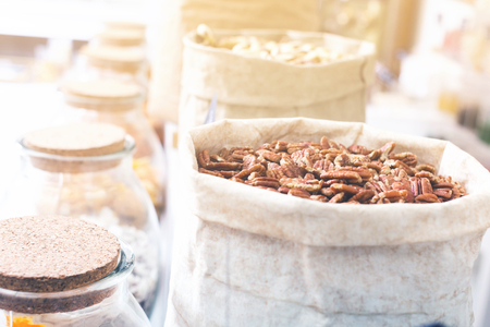 Image of dark pecan in container in the store. Stok Fotoğraf