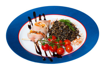 Appetizing squid stuffed with bell pepper, egg, wild rice and greens. Isolated over white background