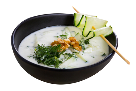Bulgarian Tarator - traditional summer chilled vegetable soup with yogurt, cucumbers, greens, walnuts. Isolated over white background Zdjęcie Seryjne