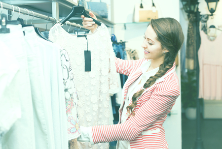 Young attractive woman doing shopping at boutique