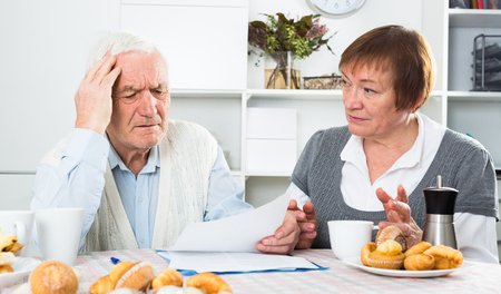 Mature family having difficulties with paying utility bills and rent