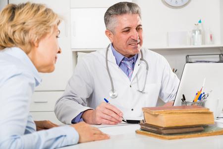 Mature professor of medicine advising his colleague on scientific issues Stock Photo