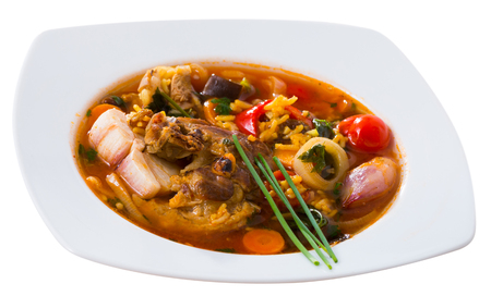 Delicious savory kharcho soup with lamb - traditional dish of Georgian cuisine. Isolated over white background