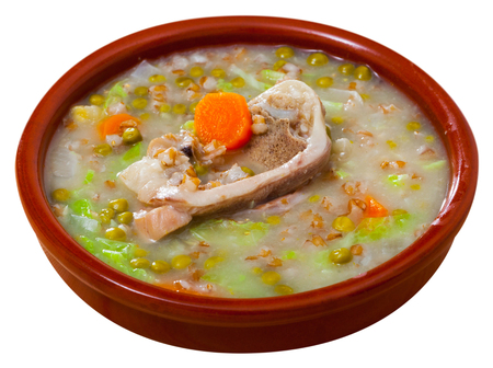 Traditional Scotch broth with barley groats, lamb, cabbage and peas. Isolated over white background Stock Photo