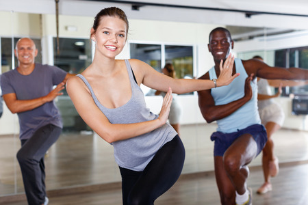 Cheerful  glad friendly  people practicing vigorous lindy hop movements in dance class Stock Photo