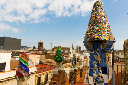 BARCELONA, SPAIN - SEPTEMBER 02, 2018: Magical rooftop of Palau Guell with chimneys and central spire designed by architect Antoni Gaudi
