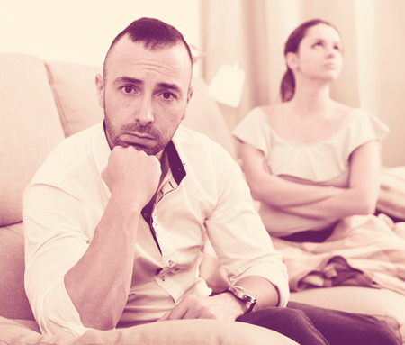 Sad male is depressing and husband is supporting him at home.