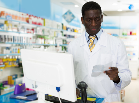Confident young pharmacist working in pharmacy, counseling customer about prescribed medication