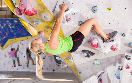 Young sporty woman training at bouldering gym without special climbing equipment Banco de Imagens - 110197148