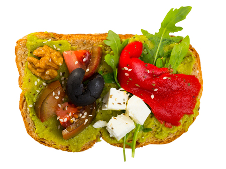 Delicious sandwich with guacamole, fresh tomatoes, sweet pepper and feta cheese. Isolated over white background 版權商用圖片