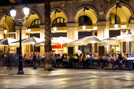 Famous Placa Reial (Royal Square) illuminated at night in Barcelona