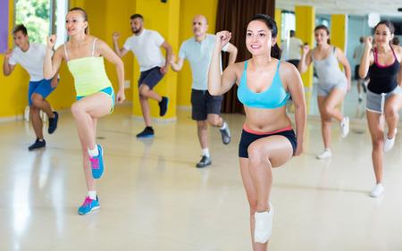 Positive people are dancing aerobics in dance class. Standard-Bild