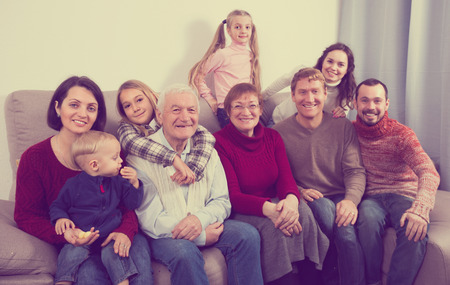 Grandparents 60-70 years old with children are photographing best moments during Christmas dinner. Stock Photo