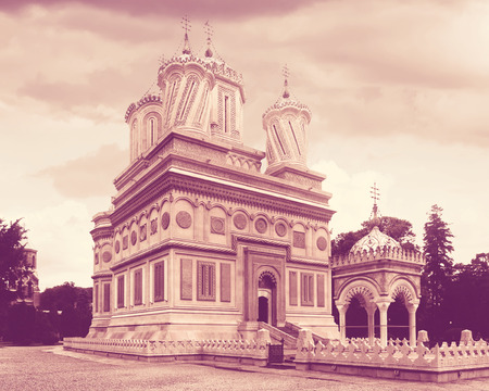 Cathedral in Curtea de Arges is architectural landmark outdoors.