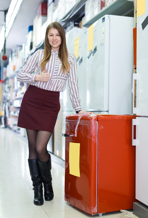 Portrait of young attractive girl in store of house appliances