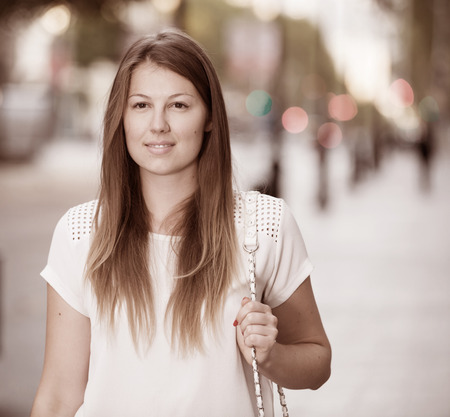 Closeup face of romantic girl walking through city streets Stock Photo