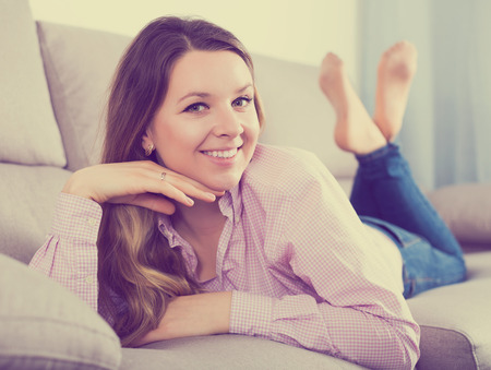 Happy woman posing easily with good mood in free time Фото со стока