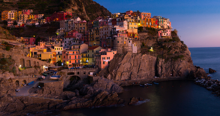 View on night light of Manarola in the province of La Spezia in Italy outdoors.