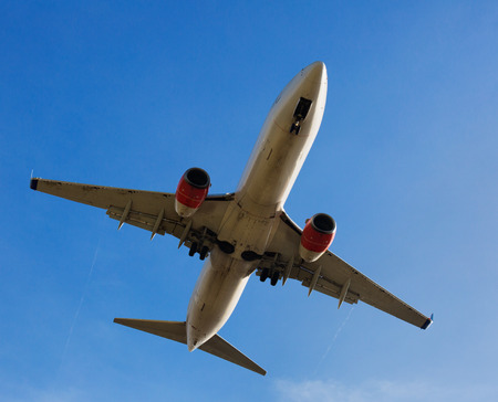 Large passenger airplane taking off from airport during day