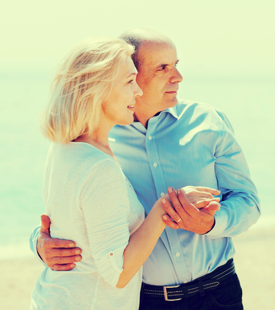 Happy mature couple together with  beach in background Stock Photo
