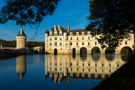 View from Cher river of impressive medieval Chateau de Chenonceau with its gallery and Tour de Marques