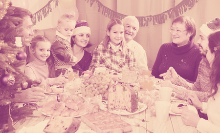 Large happy american family talking animatedly during Christmas dinner Stock Photo