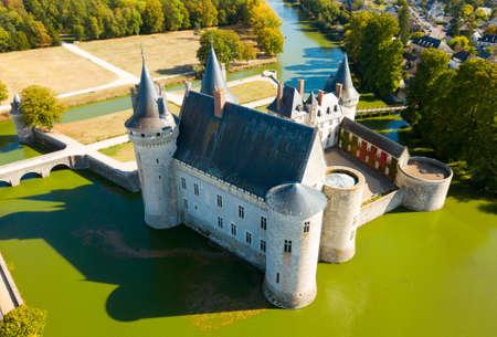 Picturesque autumn landscape with imposing medieval fortress of Chateau de Sully-sur-Loire, France Redakční