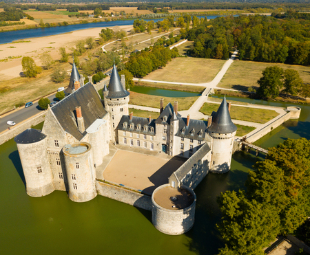 Picturesque autumn landscape with imposing medieval fortress of Chateau de Sully-sur-Loire, France Editöryel