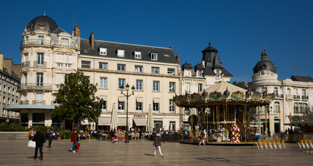 ORLEANS, FRANCE - October 09, 2018: View of main square of Orleans - Place du Martroi with old-fashioned style carousel in sunny autumn day