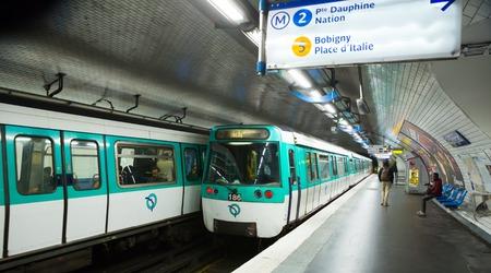 PARIS, FRANCE - OCTOBER 10, 2018:  People waiting train on platform of Paris metro station Stalingrad Editöryel